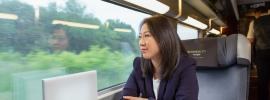 TGV Lyria - business woman in the BUSINESS 1ERE class